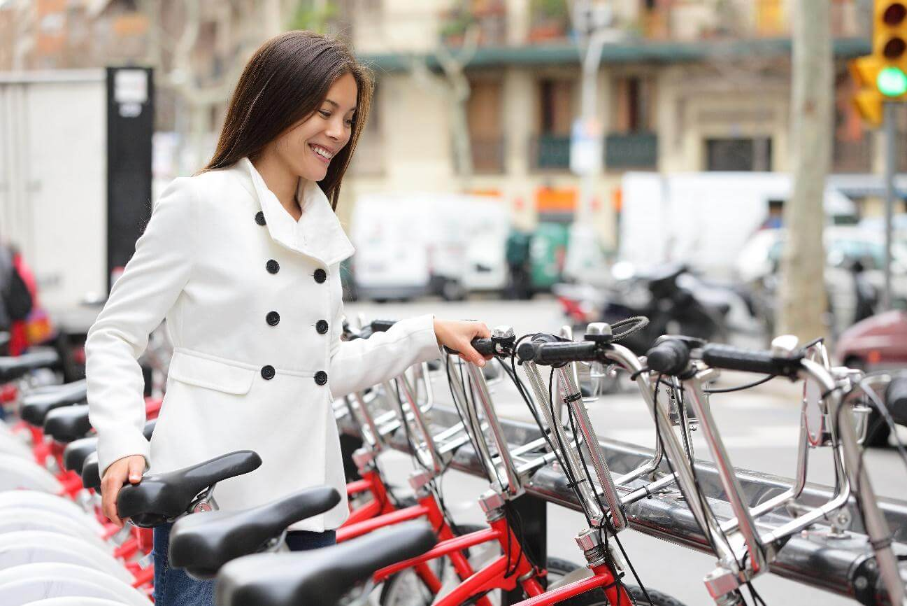 woman enjoying bike sharing services