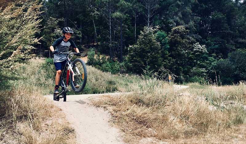 boy riding his bike on rough terrain
