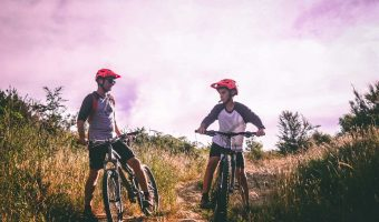 two boys riding their mountain bikes