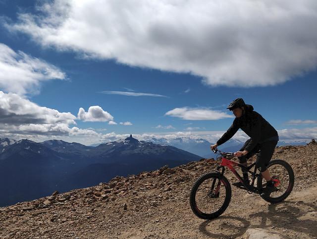 person reading mountain bike